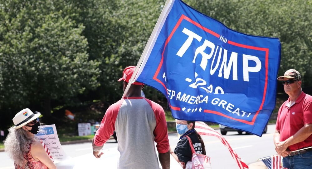 Protesters and supporters gather outside Trump National Golf Club, while U.S. President Donald Trump plays golf, in Sterling, Virginia, U.S., August 2, 2020