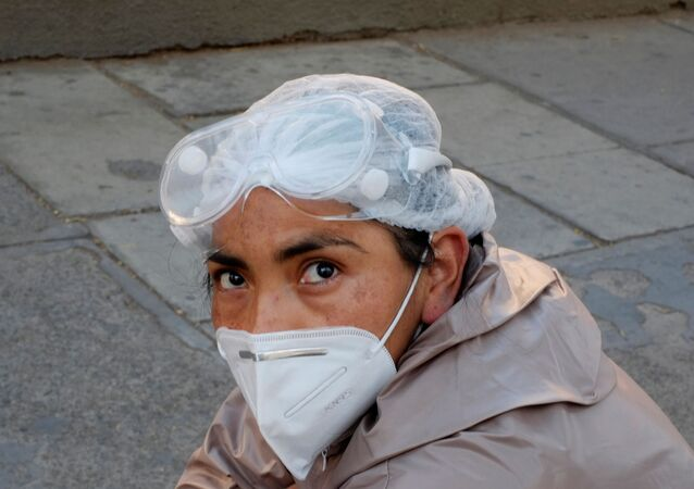 A woman wearing a protective suit waits for health information about her relative infected with coronavirus disease (COVID-19) at the Hospital de Clinicas, in La Paz, Bolivia, July 26, 2020.