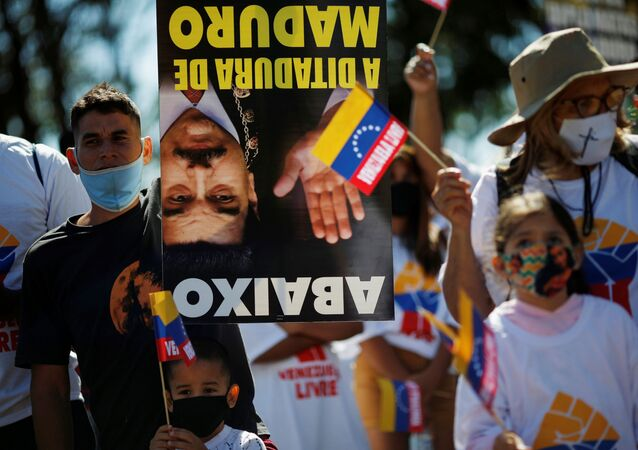 Supporters of Venezuelan opposition leader Juan Guaido attend a protest against Venezuela's President Nicolas Maduro during Venezuela's Independence Day celebration next to the embassy in Brasilia, Brazil, July 5, 2020.