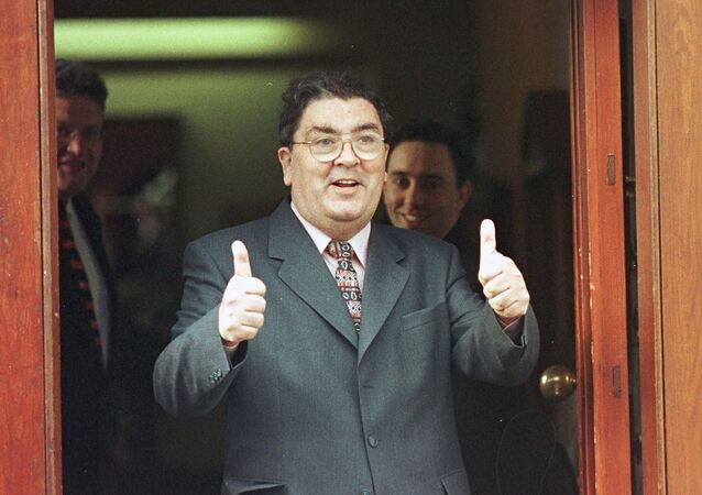 SDLP leader John Hume is in buoyant mood as he arrives for a breakfast meeting with British Prime Minister Tony Blair in 1998.