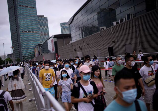 People arrive to attend the China Digital Entertainment Expo and Conference (ChinaJoy) in Shanghai, following the coronavirus disease (COVID-19) outbreak, China July 31, 2020.