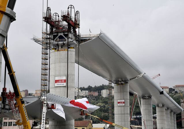 The final chunk of Genoa's new bridge is hoisted into position in April 2020. It replaces a bridge which collapsed in 2018, killing 43 people.
