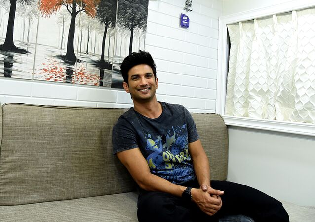 Indian Bollywood actors Sushant Singh Rajput poses inside the make-up vanity van before a promotional event for the upcoming romantic drama Hindi film 'Kedarnath' in Mumbai on November 29, 2018