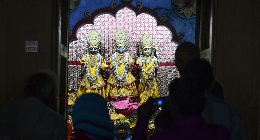 In this picture taken on November 12, 2019, devotees worship inside Ram temple at a Ram Janmabhoomi Nyas workshop in Ayodhya, after the Supreme Court verdict on the disputed religious site