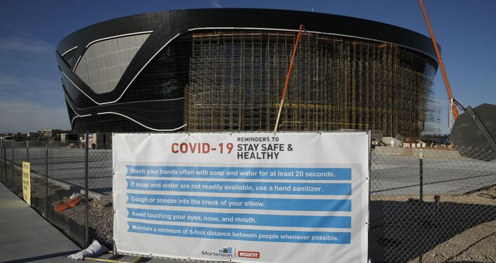 A sign gives guidelines for protection from COVID-19 outside the Allegiant Stadium, the new home of the Las Vegas Raiders NFL team.