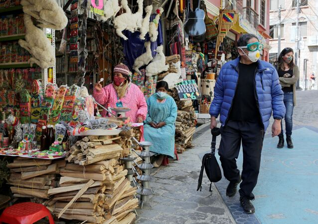 Tourists walk at the witches market in La Paz