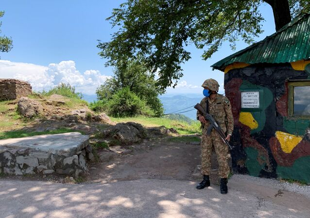 Pakistan Army soldier stands guard at a hilltop post during a trip organised by the army, near the Line of Control (LoC), in Charikot Sector, Kashmir July 22, 2020