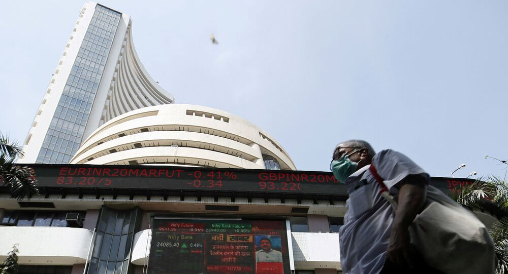 A man wearing a protective mask walks past the Bombay Stock Exchange (BSE) building in Mumbai, India, March 13, 2020