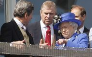 Britain's Queen Elizabeth II, right, talks to her son Prince Andrew, center, as she looks out from the balcony at the end of the Epsom Derby horse race at Epsom racecourse,  England at the start of a four-day Diamond Jubilee celebration to mark the 60th anniversary of  Queen Elizabeth II accession to the throne, Saturday, June 2, 2012