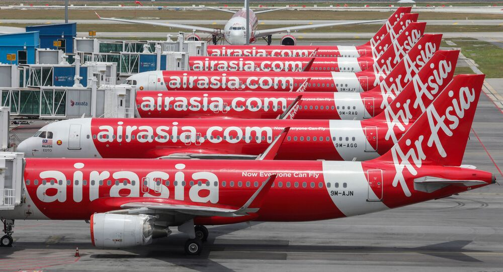 FILE PHOTO: AirAsia planes are seen parked at Kuala Lumpur International Airport 2, during the movement control order due to the outbreak of the coronavirus disease (COVID-19), in Sepang, Malaysia April 14, 2020