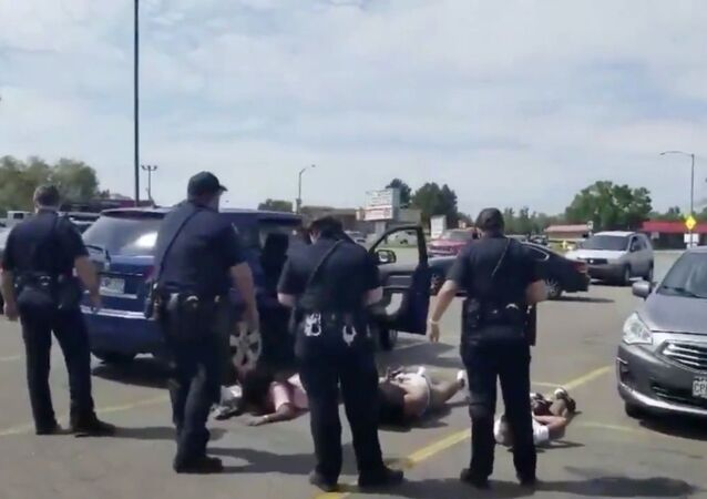 Cellphone footage captures members of Colorado's Aurora Police Department detaining and placing handcuffs on young children who were ordered to lay facedown on the ground as part of department protocol for stolen vehicle cases. The August 2, 2020, incident was later determined to be a mistake after officers determined that they'd zeroed in on the incorrect vehicle.