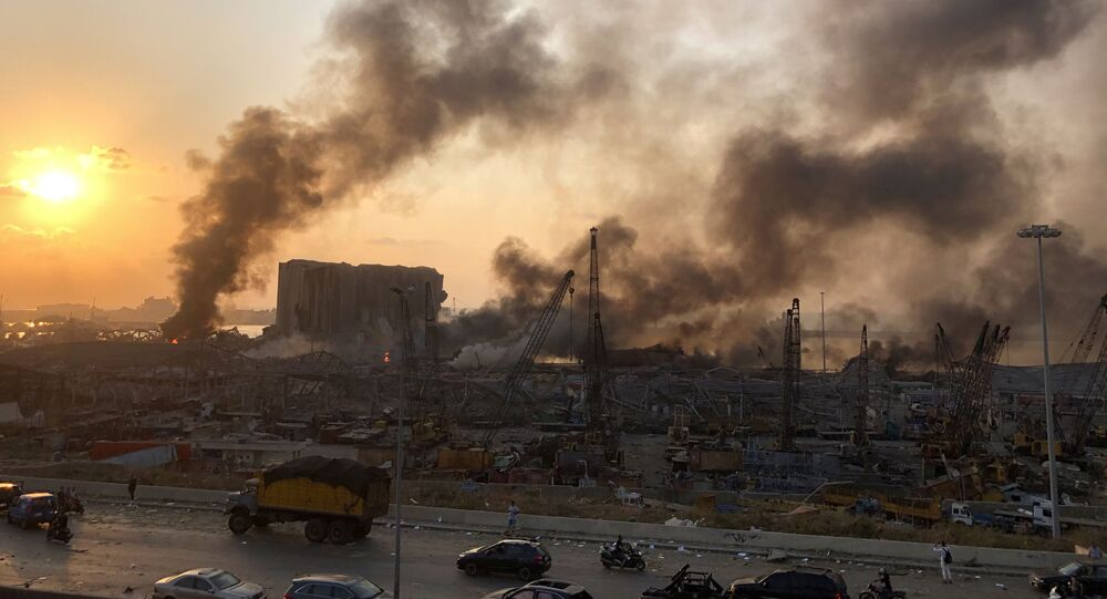 Smoke rises from the site of an explosion in Beirut, Lebanon August 4, 2020.