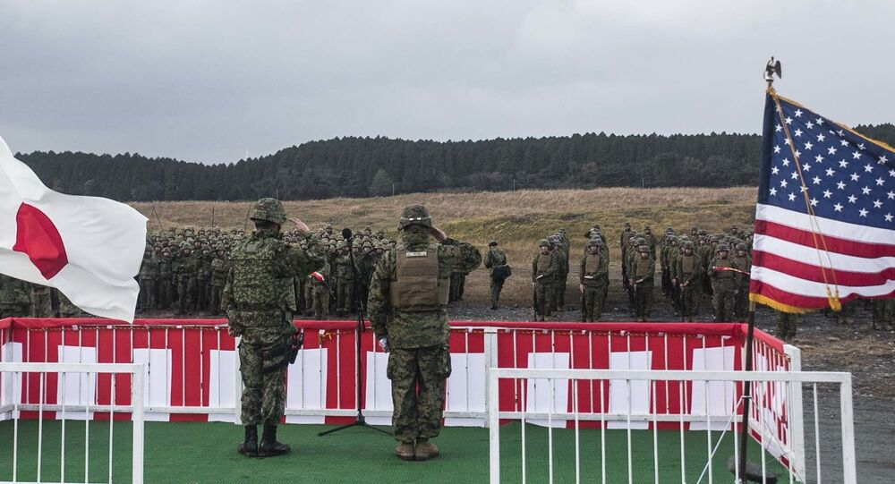 Japan Ground Self-Defense Force Col. Hiroji Yamashita, left, and U.S. Marine Maj. Roy M. Draa salute their troops Dec. 1 during the opening ceremony for Forest Light 15-1 at the Oyanohara Training Area in Yamato, Kumamoto prefecture, Japan. Forest Light is a semi-annual, bilateral exercise consisting of a command post exercise and field training event conducted by elements of III Marine Expeditionary Force and the JGSDF. Yamashita is the commanding officer with 42nd Regiment, 8th Division, Western Army, JGSDF. Draa, from Baltimore, Maryland, and is the executive officer with 2nd Battalion, 9th Marine Regiment, currently attached to 4th Marine Regiment, 3rd Marine Division, III MEF, under the unit deployment program