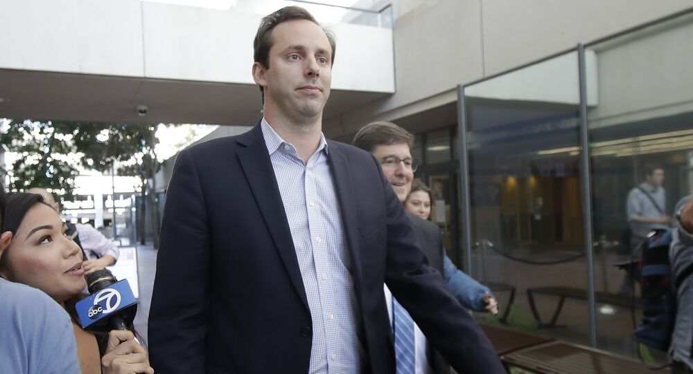 In this Aug. 27, 2019, file photo former Waymo employee Anthony Levandowski, center, leaves a federal courthouse in San Jose, Calif.