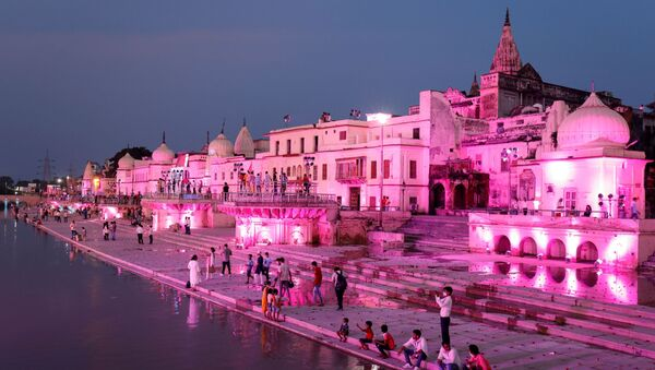 Temples and other buildings on the bank of Sarayu river are seen illuminated ahead of the foundation-laying ceremony for a Hindu temple in Ayodhya, India, August 4, 2019. - Sputnik International