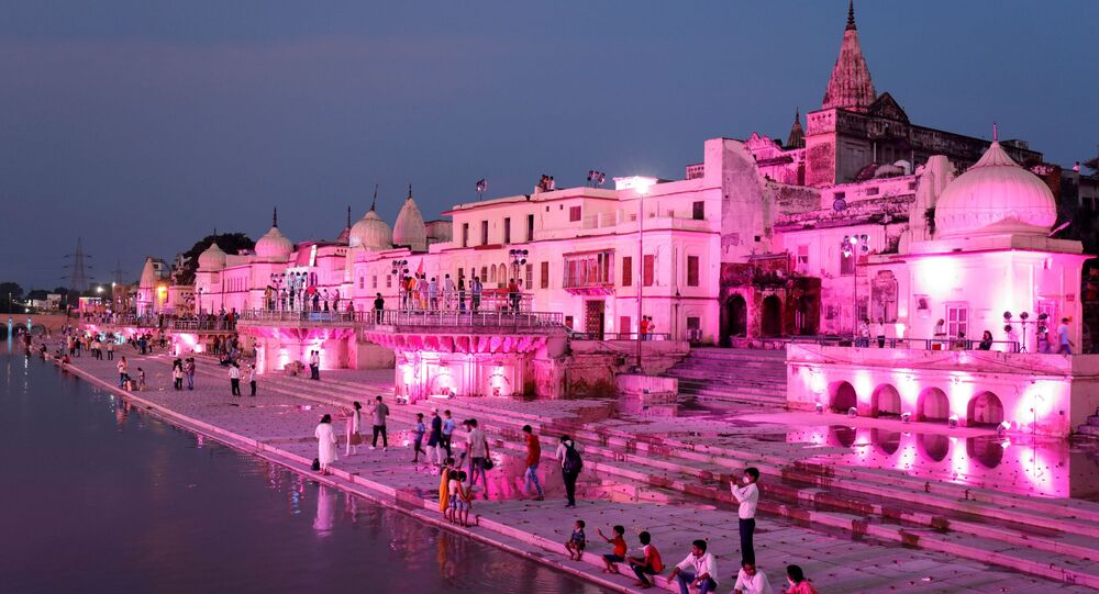 Temples and other buildings on the bank of Sarayu river are seen illuminated ahead of the foundation-laying ceremony for a Hindu temple in Ayodhya, India, August 4, 2019.