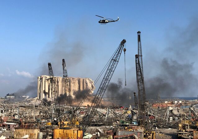 A Lebanese army helicopter flies over the site of Tuesday's blast in Beirut's port area, Lebanon 5 August 2020