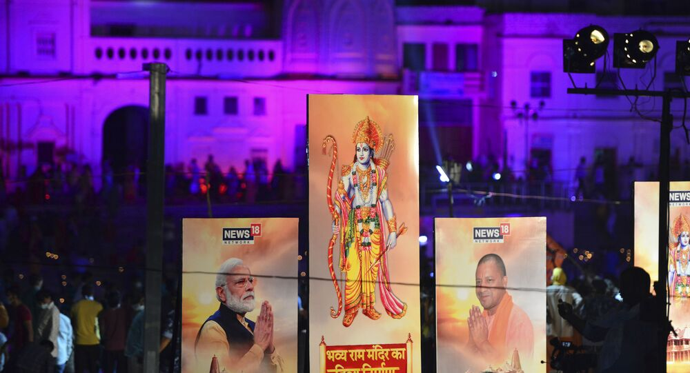 Banners with the images of (L-R) Indian Prime Minister Narendra Modi, Lord Ram and Chief Minister of Uttar Pradesh Yogi Adityanath are seen along the banks of the River Sarayu on the ever before the groundbreaking ceremony of the proposed Ram Temple in Ayodhya on August 4, 2020.