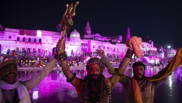 Indian Hindu holy men shout religious slogans on the eve of a groundbreaking ceremony of a temple dedicated to the Hindu god Ram in Ayodhya, India, Tuesday, Aug. 4, 2020 - Sputnik International
