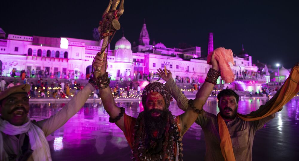 Indian Hindu holy men shout religious slogans on the eve of a groundbreaking ceremony of a temple dedicated to the Hindu god Ram in Ayodhya, India, Tuesday, Aug. 4, 2020