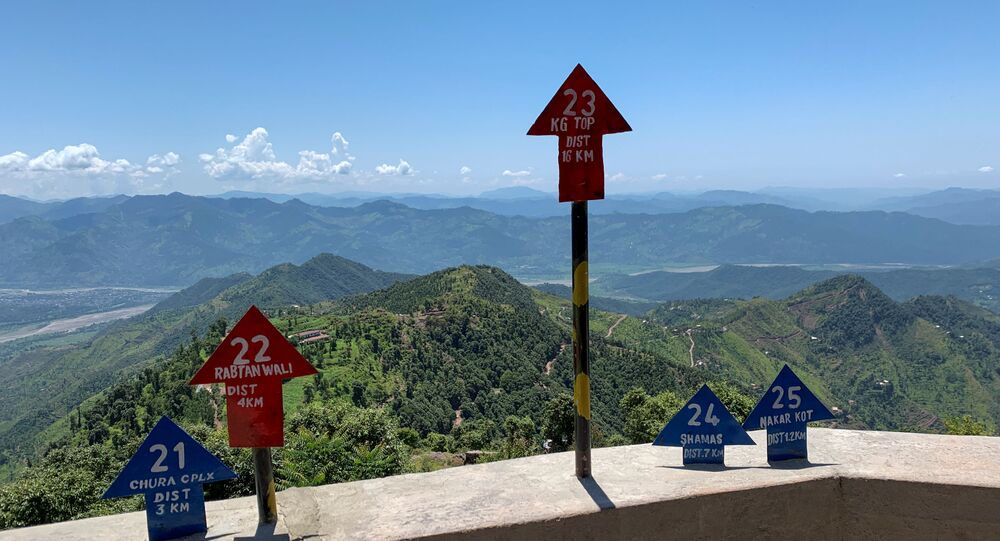 Signs displaying area distance are seen at a hilltop post during a trip organised by the army, near the Line of Control (LoC), in Charikot Sector, Kashmir July 22, 2020