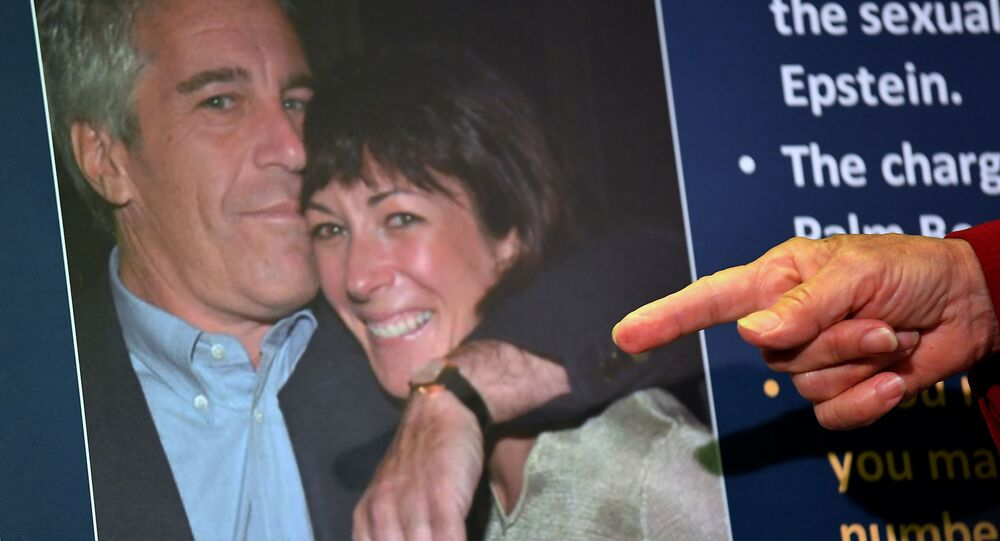 (FILES) In this file photo taken on July 2, 2020 a photo of Ghislaine Maxwell and Jeffrey Epstein is seen as acting US Attorney for the Southern District of New York, Audrey Strauss, announces charges against Maxwell during a press conference in New York City
