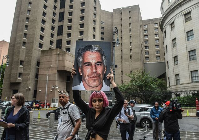 NEW YORK, NY - JULY 08: A member of a protest group called Hot Mess holds up a sign of Jeffrey Epstein in front of the Metropolitan Correction Center on July 8, 2019 in New York City