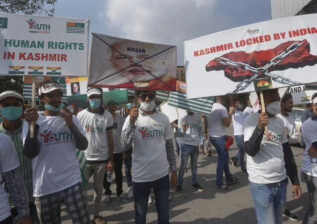 Members of the civil society group Youth Forum for Kashmir take part in a rally to show solidarity with Kashmiri people on the eve of first anniversary of India's decision to revoke the disputed region's semi-autonomy, in Lahore, Pakistan, Wednesday, Aug. 5, 2020