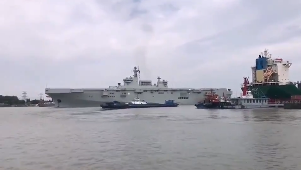China's Type 075 landing helicopter dock (LHD) sets sail for the first time on August 5, 2020 - Sputnik International