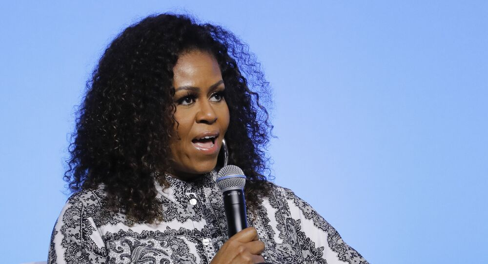 In this Dec. 12, 2019, file photo, former first lady Michelle Obama speaks during an event for Obama Foundation in Kuala Lumpur, Malaysia.