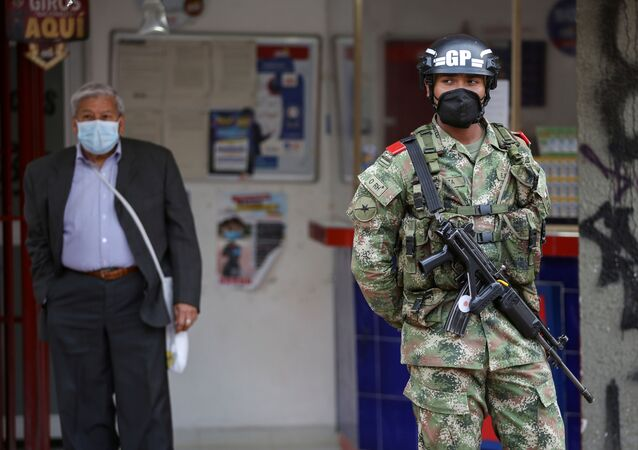 A military police officer wearing a face mask patrols a street during the government-mandated quarantine to lower the rates of contagion from the coronavirus disease (COVID-19) outbreak, in Bogota, Colombia July 27, 2020.