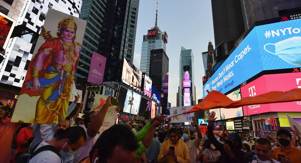 People gather in Times Square to celebrate the building of a temple on disputed grounds in northern India on August 5, 2020 in New York City.