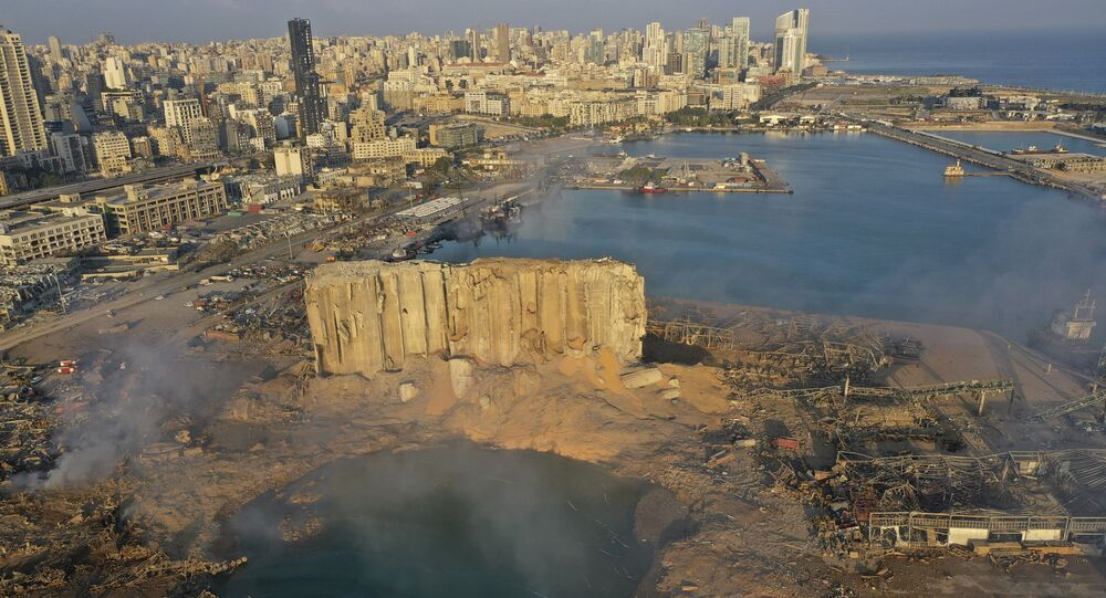 A drone picture shows the scene of an explosion that hit the seaport of Beirut, Lebanon, Wednesday, Aug. 5, 2020.