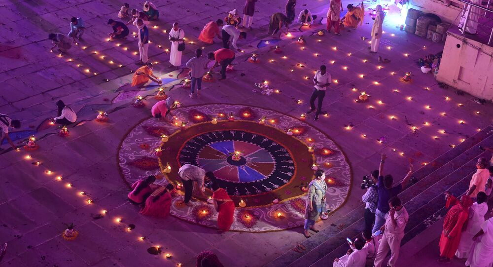 Hindu devotees light earthen lamps on the banks of the River Sarayu on the eve before the groundbreaking ceremony of the proposed Ram Temple in Ayodhya on August 4, 2020.