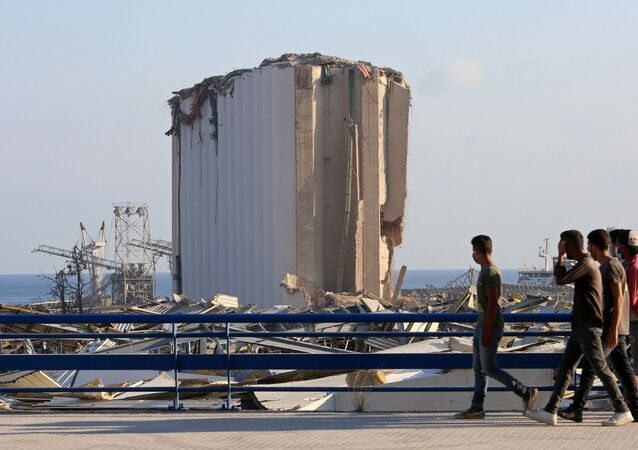 People walk near the site of Tuesday's blast in Beirut's port area, Lebanon August 6, 2020. REUTERS/Aziz Taher