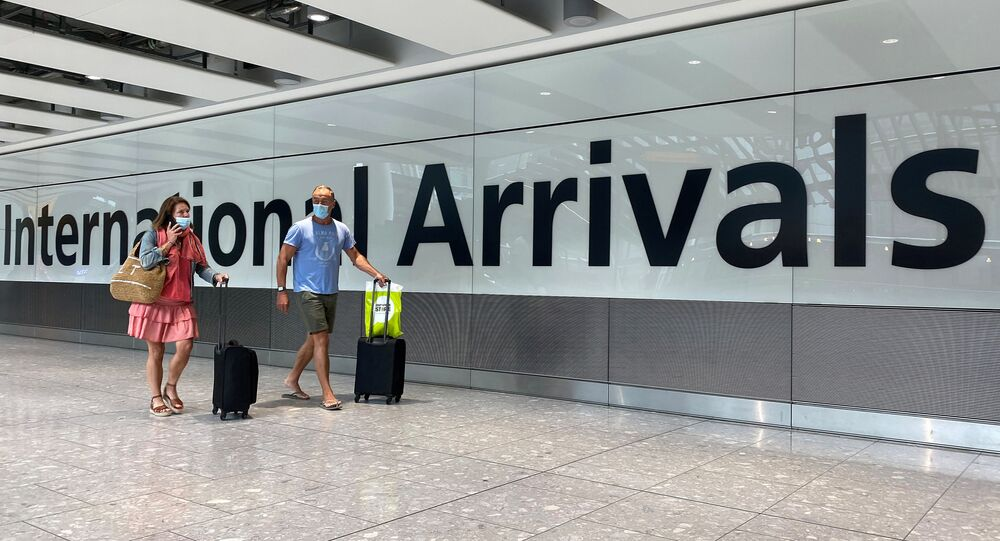 Passengers from international flights arrive at Heathrow Airport