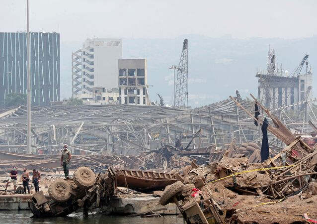 People are pictured at the devastated site of the explosion at the port of Beirut, Lebanon August 6, 2020.