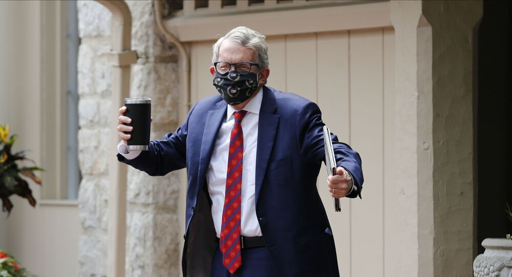 Ohio Governor Mike DeWine shrugs his shoulders in response to a reporter's question about him testing positive for COVID-19 Thursday, Aug. 6, 2020, in Bexley, Ohio