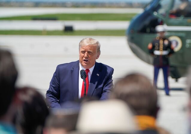 U.S. President Donald Trump speaks to supporters gathered to greet him as he stands in front of the Marine One helicopter during his arrival at Burke Lakefront Airport in Cleveland, Ohio, U.S., August 6, 2020