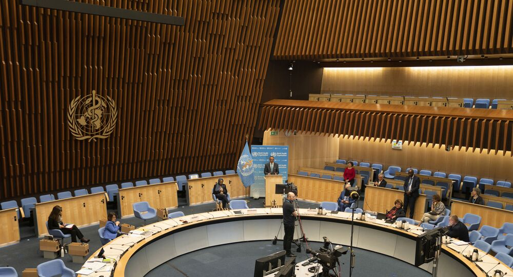 This handout photo provided by the World Health Organization (WHO) on May 18, 2020, shows a general view of the World Health Organization assembly room with WHO Director-General Tedros Adhanom Ghebreyesus delivering a speech in front of a blue backdrop at the opening of the World Health Assembly virtual meeting