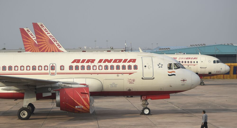 In this photograph taken on March 2, 2020, an Air India plane is parked at Indira Gandhi International airport in New Delhi.