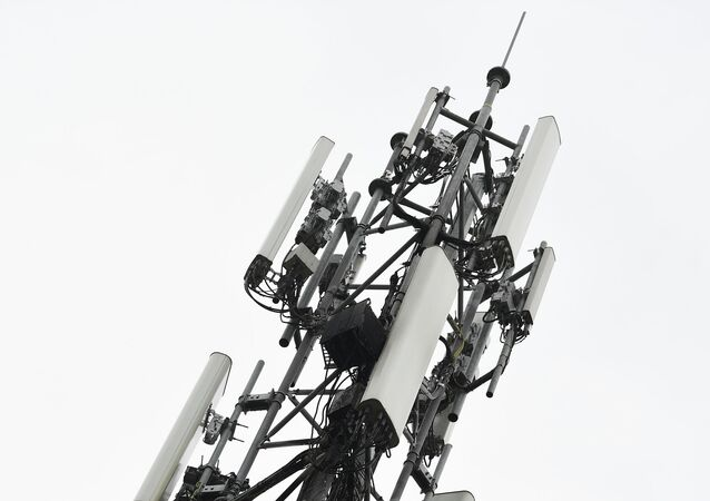 A 5G mast erected by telecom operator 'Proximus' that was set on fire, in Peltheide, Limburg province on the eve of April 19, 2020. A fake theory circulating on social media claiming the radiation of 5G masts has been linked to the noval coronavirus, COVID-19, that has swept across the continents killing many thousands of people.