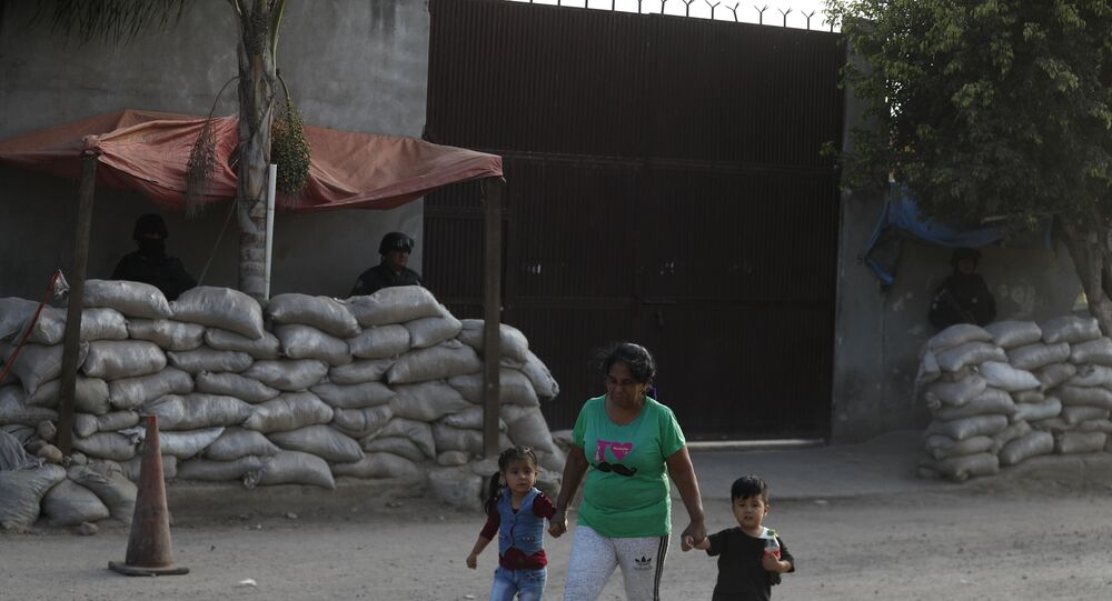 Police outside the entrance to one of the former homes of Jose Antonio Yepez Ortiz in Guanajuato state