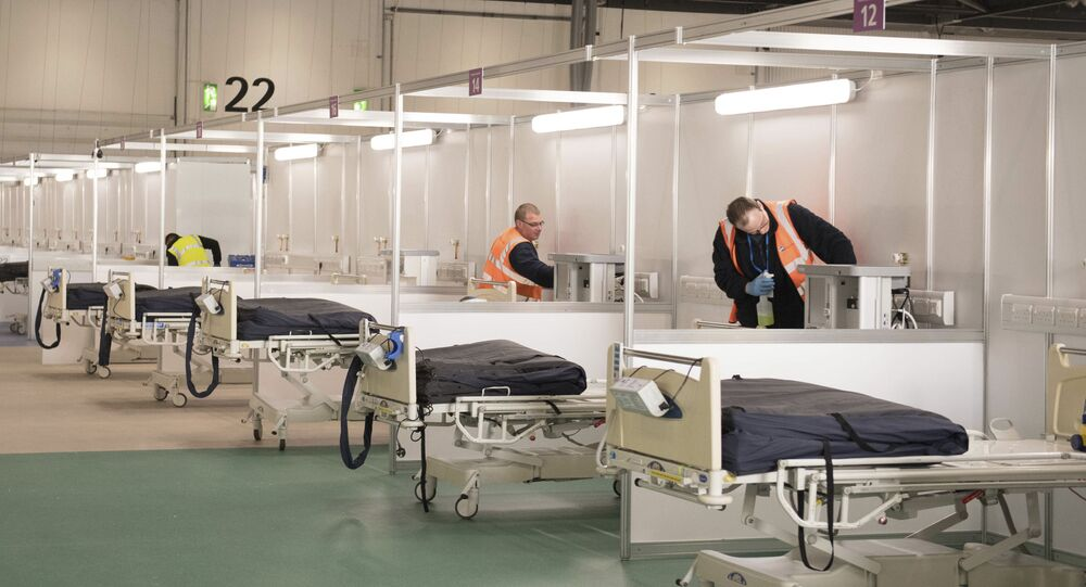 Private contractors help to prepare the ExCel centre which has temporarily been transformed into the NHS Nightingale hospital, in London, Monday, March 30, 2020. The makeshift hospital comprises of two wards with the capacity to hold up to 2,000 people in each
