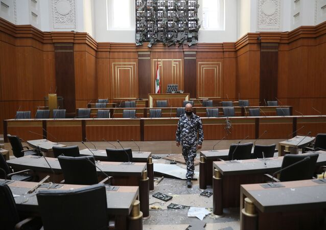 A member of the Lebanese security forces inspects damages in the Parliament building in the central district of the capital Beirut, on August 5, 2020, a day after a massive explosion in the city's port.