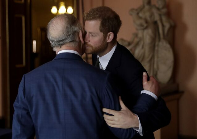 Britain's Prince Harry kisses and greets his father Prince Charles as they arrive separately at Fishmongers' Hall in the City of London for a coral reef health and resilience meeting  on Wednesday, 14 February 2018, with speeches and a reception with delegates.