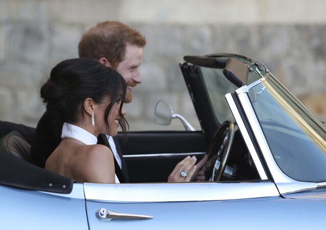 The newly married Duke and Duchess of Sussex, Meghan Markle and Prince Harry, leave Windsor Castle after their wedding to attend an evening reception at Frogmore House, hosted by the Prince of Wales
