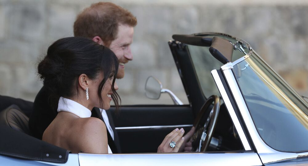 The newly married Duke and Duchess of Sussex, Meghan Markle and Prince Harry, leave Windsor Castle after their wedding to attend an evening reception at Frogmore House, hosted by the Prince of Wales.