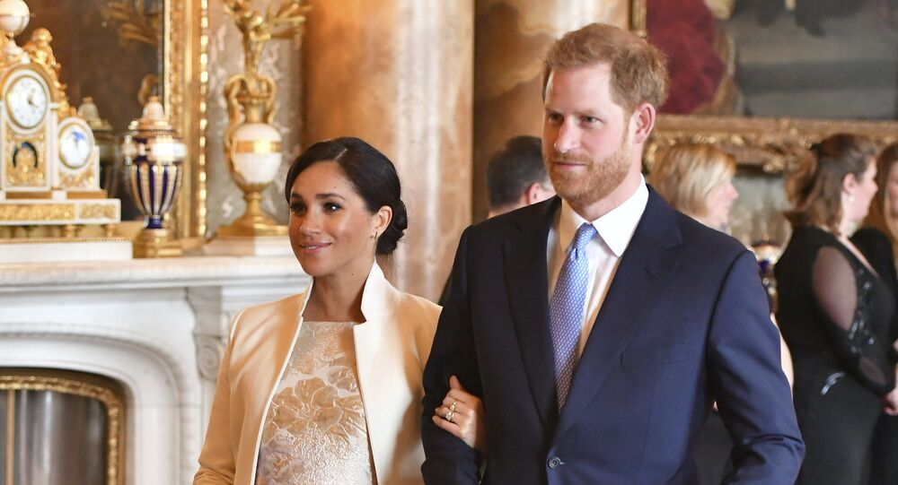 Britain's Prince Harry and Meghan, Duchess of Sussex attend a reception at Buckingham Palace, London, Tuesday March 5, 2019, to mark the fiftieth anniversary of the investiture of the Prince of Wales