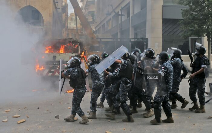 Lebanese security forces advance during clashes with protesters in downtown Beirut on August 8, 2020, following a demonstration against a political leadership they blame for a monster explosion that killed more than 150 people and disfigured the capital Beirut.